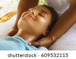 woman during neck massage | Shutterstock . vector #609532115