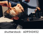close up portrait of barber... | Shutterstock . vector #609543452