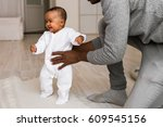 father playing with baby son at ... | Shutterstock . vector #609545156