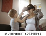 pregnant woman using vr in the... | Shutterstock . vector #609545966