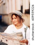 travel guide. young female... | Shutterstock . vector #609559226