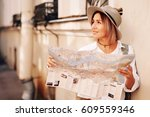 travel guide. young female... | Shutterstock . vector #609559346