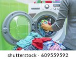 preparing the wash cycle.... | Shutterstock . vector #609559592