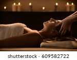 young woman enjoys massage in a ... | Shutterstock . vector #609582722