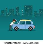 business man repairing car at...   Shutterstock .eps vector #609606608