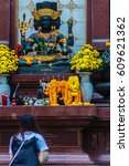 Small photo of Bangkok, Thailand - February 22, 2017: Unidentified woman is praying to black Brahma worship ceremony at the Empire Tower, Sathorn Junction Road, Bangkok, Thailand.