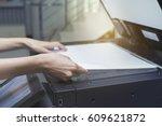 woman hands putting a sheet of... | Shutterstock . vector #609621872