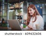 asian woman working in coffee... | Shutterstock . vector #609632606