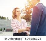 handshake between a man and a...   Shutterstock . vector #609656126