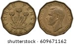 Small photo of United Kingdom British coin 3 three pence 1943, WWII issue, thrift plant allium porrum, head of King George VI left