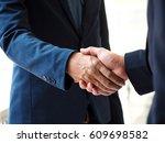 businessmen handshake  business ... | Shutterstock . vector #609698582