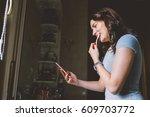 young beautiful woman washing... | Shutterstock . vector #609703772