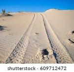 tire tread patterns on sand in... | Shutterstock . vector #609712472