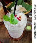 Small photo of Thai Drinks, Lichi Soda with roses and peppermint on top.