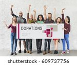 group of people holding banner... | Shutterstock . vector #609737756