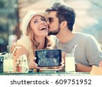 young couple taking a photo of... | Shutterstock . vector #609751952