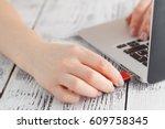 female hand inserting flash... | Shutterstock . vector #609758345