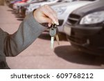 person handing keys to someone... | Shutterstock . vector #609768212