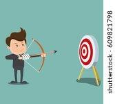 businessman shooting arrow  ...   Shutterstock .eps vector #609821798
