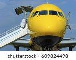 yellow passenger plane with... | Shutterstock . vector #609824498