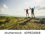 young couple hiking on the... | Shutterstock . vector #609826868