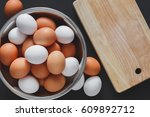 Fresh Brown Eggs In Bowl And...