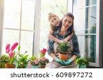 cute child girl helps her... | Shutterstock . vector #609897272