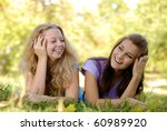 two teenage girls having fun... | Shutterstock . vector #60989920