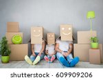 happy family playing into new... | Shutterstock . vector #609909206