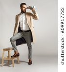 stylish man in a suit and a... | Shutterstock . vector #609917732