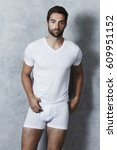 handsome dude in shorts and t... | Shutterstock . vector #609951152