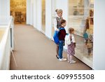 guide of museum showing little... | Shutterstock . vector #609955508