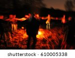 ritual dances near camp fire at ... | Shutterstock . vector #610005338