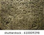 hieroglyphics engraves on stone | Shutterstock . vector #610009298