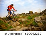 cyclist riding the mountain... | Shutterstock . vector #610042292