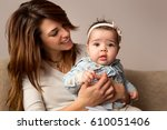 young mother holding her baby...   Shutterstock . vector #610051406