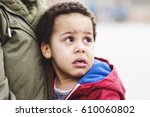 Small photo of Portrait of a little upset toddler boy crying.
