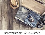 travel concept on wooden table | Shutterstock . vector #610065926