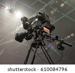tv camera in a concert hal.... | Shutterstock . vector #610084796