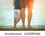 father and son stay on the sea... | Shutterstock . vector #610089686