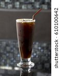 Small photo of ice coffee americano in a glass