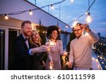 friends enjoying a rooftop... | Shutterstock . vector #610111598