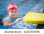 young girl learning to swim in... | Shutterstock . vector #610155698