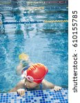 young girl learning to swim in... | Shutterstock . vector #610155785