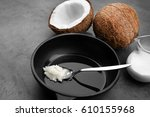 spoon with coconut oil on... | Shutterstock . vector #610155968