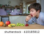 caucasian boy is enjoying... | Shutterstock . vector #610185812