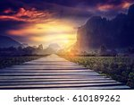 wooden footpath in a field at... | Shutterstock . vector #610189262