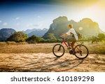 happy tourist woman riding a... | Shutterstock . vector #610189298