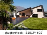 modern villa  exterior with lawn | Shutterstock . vector #610194602