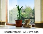 teddy sitting next to the... | Shutterstock . vector #610195535